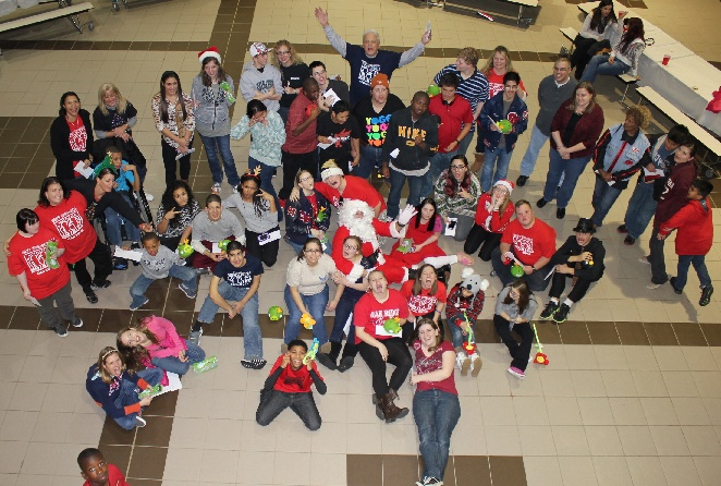 Students in Best Buddies celebrate the holidays during dance sponsored by Planet Ford