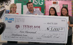 Alexa Horack and Shawn Burns present Stephanie Luu and her mother with scholarship check.